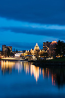 The Inner Harbour of Victoria is a mirror of lights from the Legislature buildings at night.