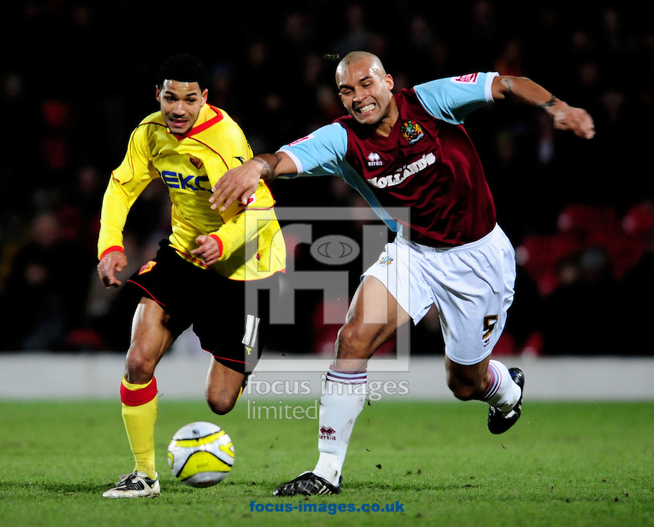 London - Tuesday, January 27th, 2009: Jobi McAnuff of Watford and Clarke Carlisle of Burnley battle during the Coca Cola Championship match at Vicarage Road, London. (Pic by Daniel Hambury/Focus Images)