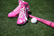 LOS ANGELES, CA - MAY 12:  Pink shoes, a baseball with pink seams, and a pink bat lie on the grass before being used in the Los Angeles Dodgers game in honor of Mother's Day during the game against the Miami Marlins on Sunday, May 12, 2013 at Dodger Stadium in Los Angeles, California. The Dodgers won the game 5-3. (Photo by Paul Spinelli/MLB Photos via Getty Images)