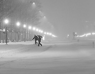 Essential employees make their way to work as they cross Pennsylvania Ave. early Saturday morning in Washington, D.C., January 23, 2015.  Snow began falling in the nation's capital Friday and may accumulate as much as 24 inches by Sunday Morning.   Photo by Bryan Woolston / for The Daily Mail.