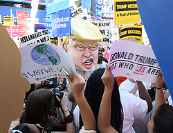 Oct. 19, 2016 - Las Vegas, Nevada, U.S. - TOM MORAN, center, wears a large Trump head in the middle of the the rally at UNLV hours before the debate Wednesday. The third and final debate will be held Wednesday night at Las Vegas Nevada University. (Credit Image: © Gene Blevins via ZUMA Wire)