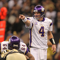 Jan 24, 2010; New Orleans, LA, USA; Minnesota Vikings quarterback Brett Favre (4) at the line against the New Orleans Saints during the first quarter of the 2010 NFC Championship game at the Louisiana Superdome. Mandatory Credit: Derick E. Hingle-US PRESSWIRE