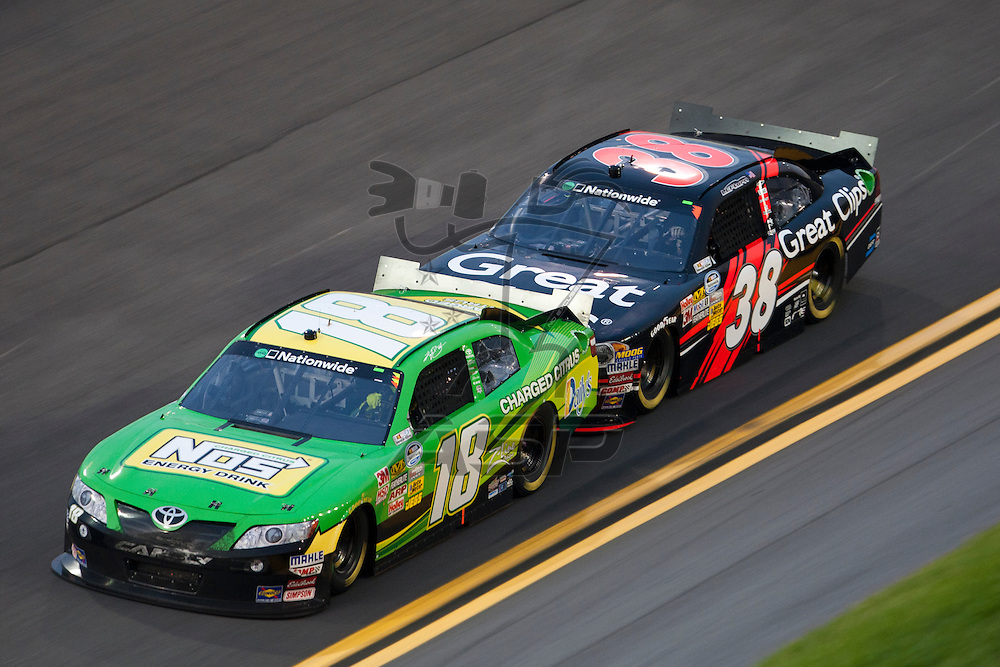 Daytona Beach, FL - July 01, 2011: Kyle Busch (18) races off turn four during the Subway Jalapeno 250 at Daytona International Speedway in Daytona Beach, FL.