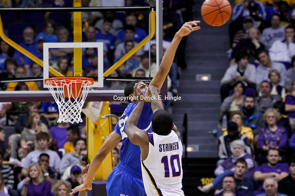 January 28, 2012; Baton Rouge, LA; Kentucky Wildcats forward Anthony Davis (23) blocks a shot by LSU Tigers guard Andre Stringer (10) during the second half of a game at the Pete Maravich Assembly Center. Kentucky defeated LSU 74-50.  Mandatory Credit: Derick E. Hingle-US PRESSWIRE