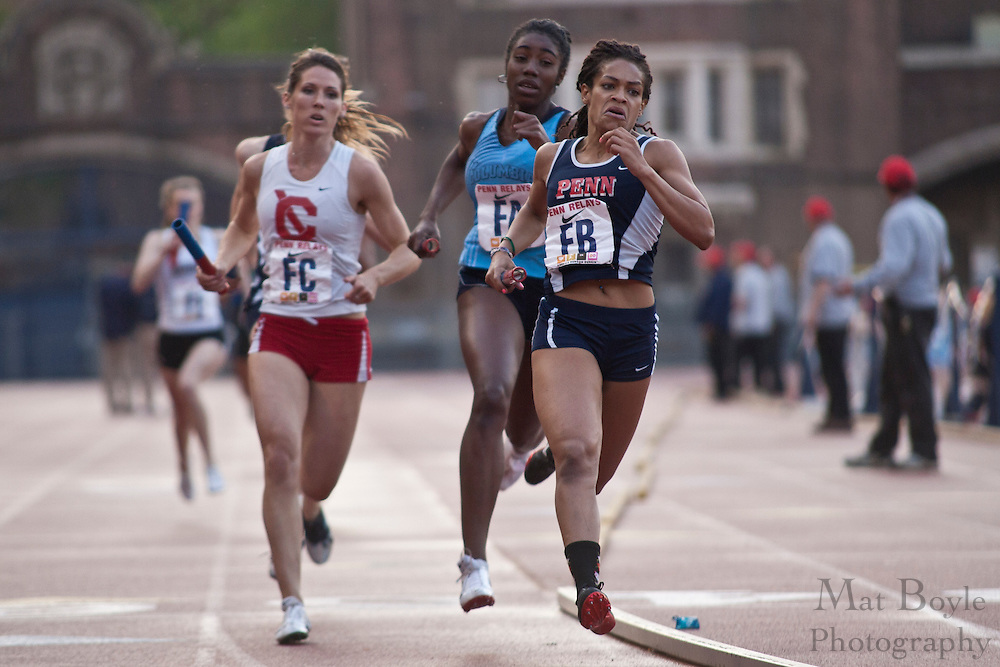 Racers enter the back turn during College Women's 4x400 Heptagonal at the 2010 Penn Relays.
