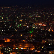 Green lights mark the minarets in this night view from Mount Qasioun, Damascus