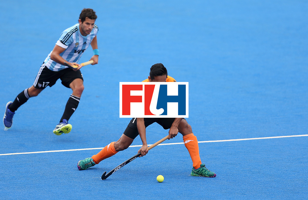 LONDON, ENGLAND - JUNE 24: Haziq Samsul of Malaysia in action during the semi-final match between Argentina and Malaysia on day eight of the Hero Hockey World League Semi-Final at Lee Valley Hockey and Tennis Centre on June 24, 2017 in London, England. (Photo by Steve Bardens/Getty Images)