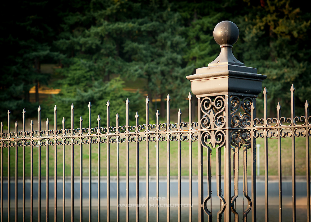 Wrought iron fence, Mount Tabor Park,  Portland, Oregon, USA. In 1903, John Charles Olmsted of the Massachusetts-based landscape design firm Olmsted Brothers recommended that a city park be developed at Mount Tabor.  Portland Parks Superintendent Emanuel T. Mische, who had worked at Olmsted Brothers, consulted with Olmsted on the park layout and integration of the reservoirs into the park design.