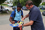 AFC Wimbledon attacker Michael Folivi (17) signing autographs during the EFL Sky Bet League 1 match between AFC Wimbledon and Rotherham United at the Cherry Red Records Stadium, Kingston, England on 3 August 2019.