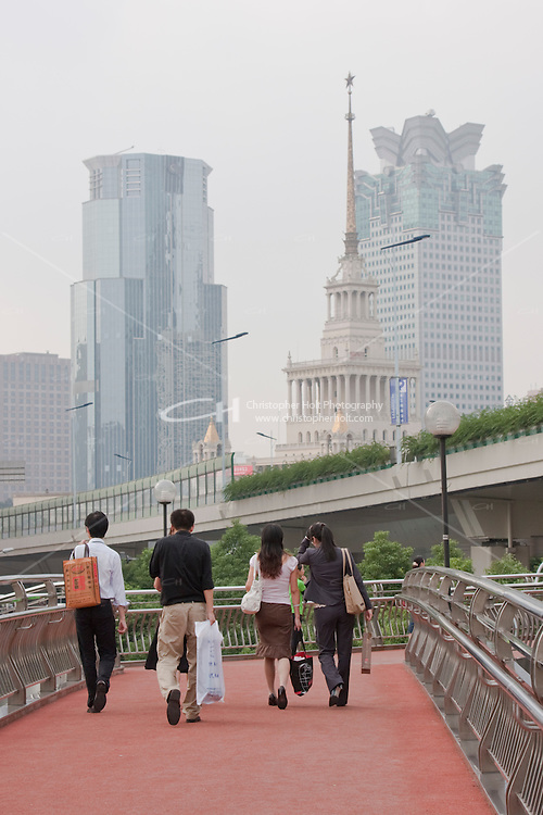 people cross road using pedestrian bridges in Shanghai China