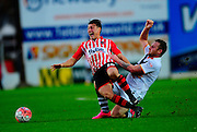 Exeter City's Lee Holmes is tackled by Port Vale's Chris Birchall during the The FA Cup match between Exeter City and Port Vale at St James' Park, Exeter, England on 6 December 2015. Photo by Graham Hunt.
