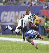 Eagles' Bryce Brown leaps over Giants' Prince Amukamara for a 7 yard gain during the 4th quarter at MetLife Stadium in East Rutherford, NJ. Eagles win 36-21.