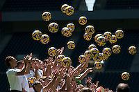 German Soccer Bundesliga 2015/16 - Photocall Borussia Moenchengladbach on 10 July 2015 in Moenchengladbach, Germany: Players of Borussia Moenchengladbach throw balls in the air.