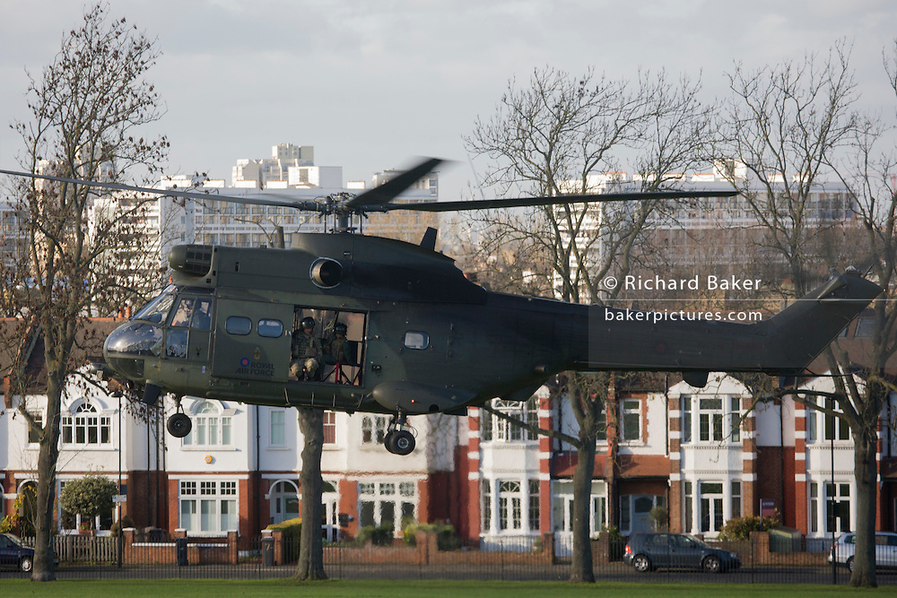 A Royal Air Force Puma troop-carrying helicopter lands in Ruskin Park in the south London borough of Lambeth. It is believed that the RAF use various public spaces as part of emergency landing/evacuation location familiarisation in readiness of a future national emergency.