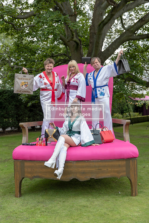A hundred guests including celebrities, Christopher Biggins, Linda Robson and Bjorn Again take part in the Princes Trust fund-raising event, Lunch with an Old Bag.<br /> <br /> 2018 marks Scotland's Year of Young People and is Lunch with an Old Bag's 10th anniversary - last year the event raised over £700,000. The bags being auctioned this year include a £24,000 Hermes handbag<br /> <br /> Pictured: Bjorn Again with a selection of the bags being auctioned