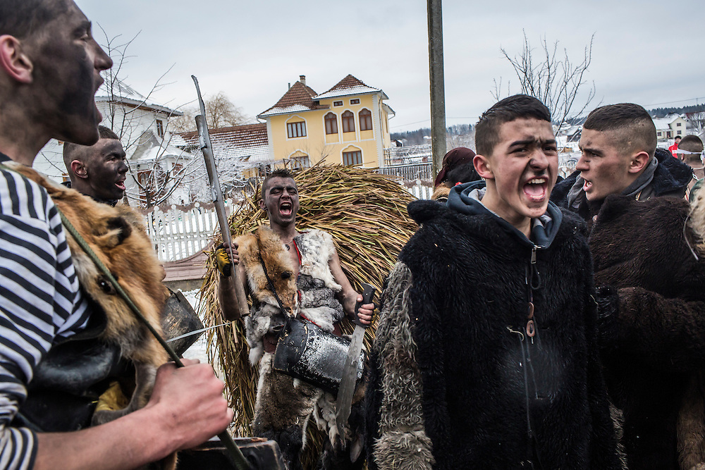 Ivan Mytryk, 15, rear center, and others in bear and gypsy costumes celebrate the Malanka Festival on Thursday, January 14, 2016 in Krasnoilsk, Ukraine. The annual celebrations, which consist of costumed villagers going in a group from house to house singing, playing music, and performing skits, began the previous sundown, went all night, and will last until evening.