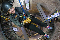 Royal Marines abseil down BT Tower. the BT Tower, London, United Kingdom. Embargoed until Monday, 17th February 2014. Picture by Anthony Upton / i-Images<br /> <br /> HISTORIC MOMENT FOR BT TOWER AS CHARITY ABSEIL GETS THE GREEN LIGHT<br /> TV presenter Helen Skelton during the training at the Castle Climbing centre, in north London ahead of the first ever charity abseil down BT Tower will take place on 10 March to raise money for Sport Relief and the Royal Marines Charitable Trust Fund using BT&rsquo;s MyDonate online fundraising site.<br /> <br /> The event will also kick off a year of celebrations for the 350th anniversary of the Royal Marines, during which the Royal Marines Charity Trust Fund (RMCTF) aim to raise &pound;6million