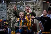 Parade watchers try to catch beads tossed by musician and Grand Marshal of Endymion, Kid Rock as he rides in the 2009 Krewe of Endymion Parade on February 21, 2009 in New Orleans, Louisiana. USA