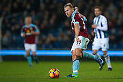 Burnley midfielder Scott Arfield (37)  lays the ball through  during the Premier League match between West Bromwich Albion and Burnley at The Hawthorns, West Bromwich, England on 21 November 2016. Photo by Simon Davies.