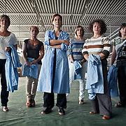 Rosa Emilia Giancola, 44 anni, operaia e delegata RSU FEMCA CISL per la Tacconi Sud di Latina, e' ritratta all'interno del capannone della fabbrica tessile occupata, insieme alle sue colleghe (da sinistra) Valeria Tulin 48 anni, Tiziana Compagno 44 anni, Silvana Romano 38 anni, Patrizia Faggion 45 anni, Antonella Arduini 41 anni . L'occupazione e' iniziata il 19 gennaio 2011 a seguito della comunicazione del licenziamento di tutte le dipendenti. La produzione dell'impianto e' ferma e l'intento delle donne e' quello di salvaguardare i materiali ancora al suo interno e di chiedere garanzie per il loro futuro lavorativo. Rosa e le sue compagne hanno lavorato alla Tacconi Sud per 20 anni.