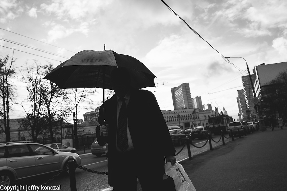 A man walk with an umbrella in Moscow