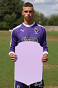 AFC Wimbledon goalkeeper Nicola Tzanev (25) holding Fifa sign during the AFC Wimbledon 2018/19 official photocall at the Kings Sports Ground, New Malden, United Kingdom on 31 July 2018. Picture by Matthew Redman.