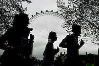 Competitors Run past the London Eye at The Virgin Money London Marathon, Sunday 26th April 2015.<br /> <br /> Photo: Thomas Lovelock for Virgin Money London Marathon<br /> <br /> For more information please contact Penny Dain at pennyd@london-marathon.co.uk