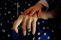 2002, Minneapolis, Minnesota, USA --- Manui Franken puts her hand on the hand of Phoebe Franken, her grandmother. --- Image by © Owen Franken/CORBIS