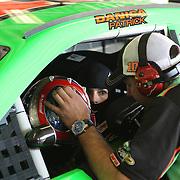 NASCAR Sprint Cup driver Danica Patrick prepares herself in her car during a NASCAR Daytona 500 practice session at Daytona International Speedway on Wednesday, February 20, 2013 in Daytona Beach, Florida.  (AP Photo/Alex Menendez)