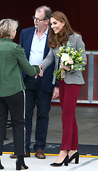 © Licensed to London News Pictures. 12/11/2019. London, UK. Kate, Duchess of Cambridge leaves the Troubadour Theatre with a bouquet of flowers. The Duke and Duchess of Cambridge attend Shout's Crisis Volunteer celebration event at the Troubadour Theatre, White City, London. The event brings together people from across the UK who volunteer around the clock with Shout to support people in crisis.. Photo credit: Alex Lentati/LNP