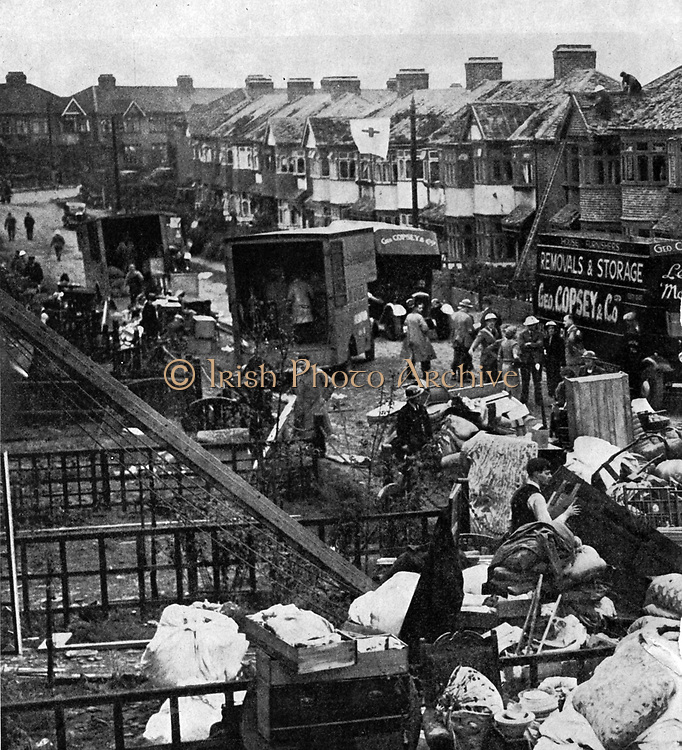 Bomb damage in a suburban street. July 1940 to May 1941 sustained bombing of British towns and cities, the Blitz, by the Luftwaffe (German Air Force)  killed 43,000 civilians and injured  51,000, and destroyed one million homes.