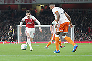 Arsenal defender Carl Jenkinson (25) and Blackpool defender Michael Nottingham (12) during the EFL Cup 4th round match between Arsenal and Blackpool at the Emirates Stadium, London, England on 31 October 2018.