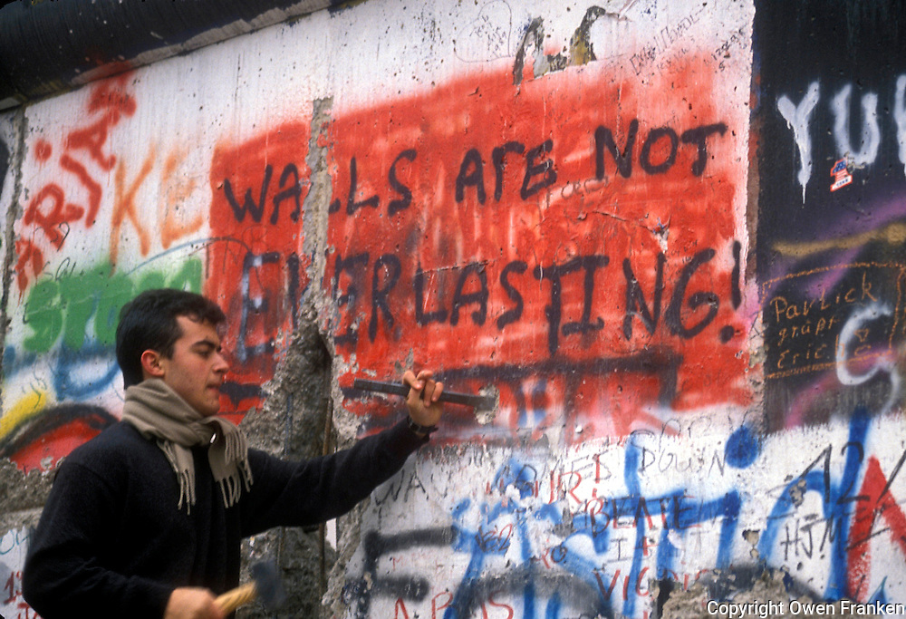 attacking the Berlin Wall, 1989 - photograph by Owen Franken