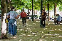 Men play Boules around Église Saint-Eustache Paris France in May 2008