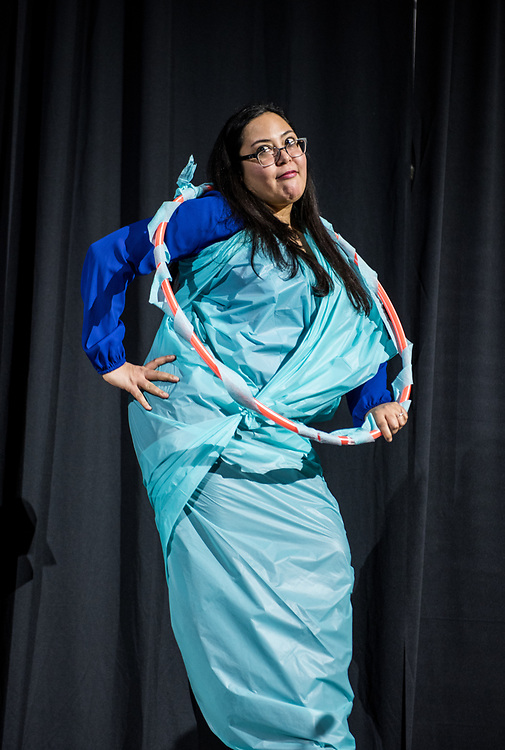 Melissa Figueroa, Assistant Spanish Profesor, shows off her 'Formal Wear' during the 2018 Faculty Pageant.