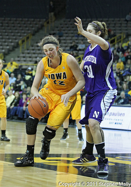 December 30, 2011: Iowa Hawkeyes center Morgan Johnson (12) works against Northwestern Wildcats forward/center Dannielle Diamant (31) during the NCAA women's basketball game between the Northwestern Wildcats and the Iowa Hawkeyes at Carver-Hawkeye Arena in Iowa City, Iowa on Wednesday, December 30, 2011.