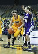 December 30, 2011: Iowa Hawkeyes center Morgan Johnson (12) works against Northwestern Wildcats forward/center Dannielle Diamant (31) during the NCAA women's basketball game between the Northwestern Wildcats and the Iowa Hawkeyes at Carver-Hawkeye Arena in Iowa City, Iowa on Wednesday, December 30, 2011.