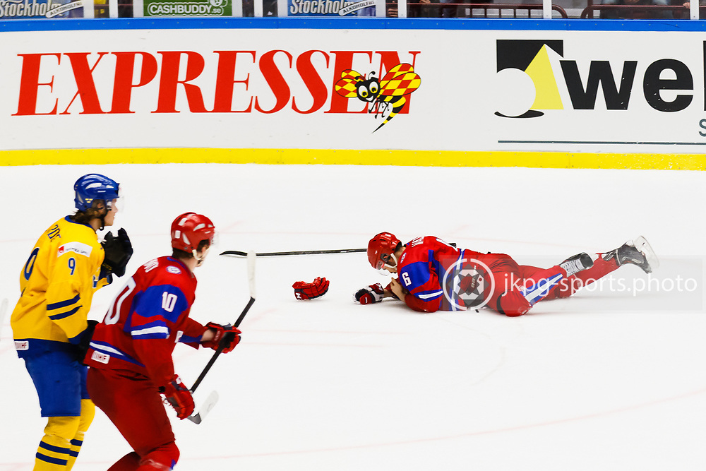 140104 Ishockey, JVM, Semifinal,  Sverige - Ryssland<br /> Icehockey, Junior World Cup, SF, Sweden - Russia.<br /> Valeri Vasiliev, (RUS) injured. Skadad.<br /> Endast f&ouml;r redaktionellt bruk.<br /> Editorial use only.<br /> &copy; Daniel Malmberg/Jkpg sports photo