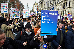 © Licensed to London News Pictures. 08/03/2020. LONDON, UK. Women with signs take part in the annual March 4 Women on International Women's Day. The event this year celebrates the power and passion of women and girls who are on the frontline of responding to climate change.  The walk through central London from Whitehall Place ends with a rally in Parliament Square.  Photo credit: Stephen Chung/LNP