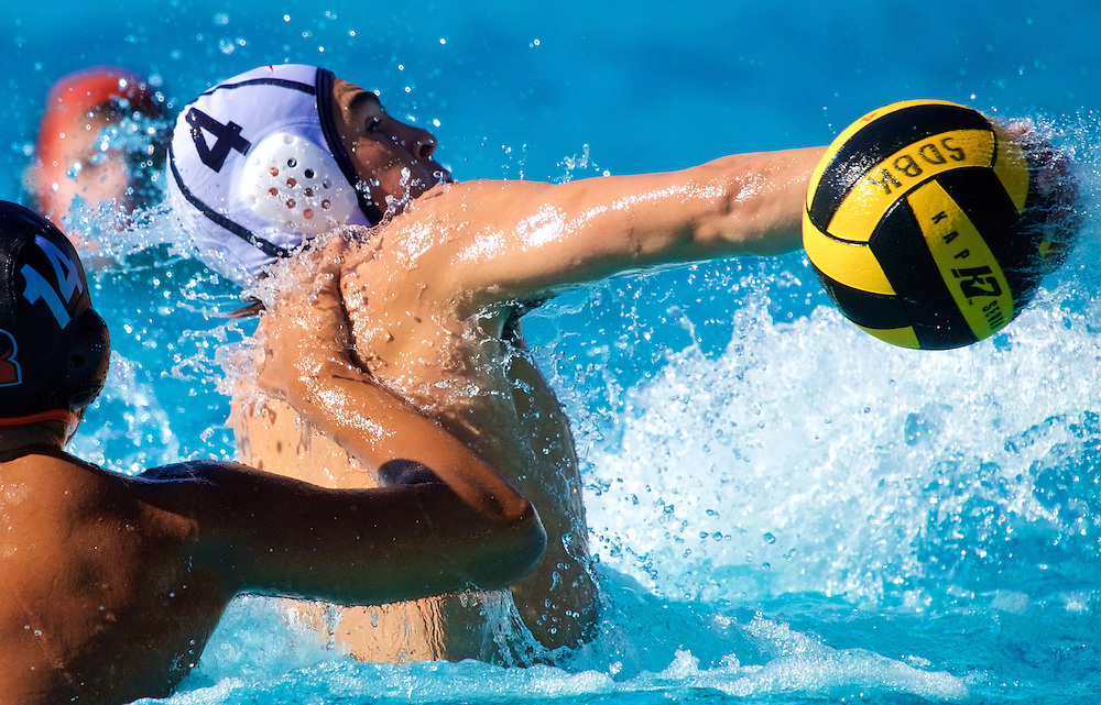 11/4/16 &ndash; Waterpolo &ndash; <br /> <br /> A Santa Ana player throws a backward pass over Riverside's Pedro Osorio during the OEC Water Polo Tournament at Saddleback College in Mission Viejo, Calif., Nov. 4, 2016.<br /> <br /> Photo by Seth Laubinger / Sports Shooter Academy