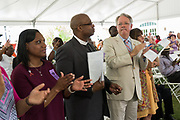 Charleston Mayor John Tecklenburg, right, joins Rev. Eric Manning and family members killed in the Mother Emanuel African Methodist Episcopal Church shooting during a memorial service marking the 2nd anniversary of the mass shooting June 17, 2017 in Charleston, South Carolina. Nine members of the historic African-American church were gunned down by a white supremacist during bible study on June 17, 2015.