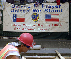 Aug 18, 2002; New York, NY, USA;  A sign from the Bexar County Sheriff's Office stands Sunday August 18, 2002 in New York, New York outside St. Paul's Chapel near the World Trade Center Ground Zero site as a construction worker conintues to repair damage from the September 11 attack.    (Credit Image: © William Luther/San Antonio Express-News/ZUMAPRESS.com)