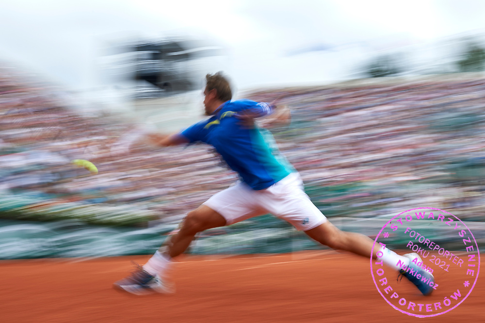 Paris, France - 2017 June 03: Stan Wawrinka from Switzerland plays a backhand while his men's single match third round during tennis Grand Slam tournament The French Open 2017 (also called Roland Garros) at Stade Roland Garros on June 03, 2017 in Paris, France.<br /> <br /> Mandatory credit:<br /> Photo by &copy; Adam Nurkiewicz<br /> <br /> Adam Nurkiewicz declares that he has no rights to the image of people at the photographs of his authorship.<br /> <br /> Picture also available in RAW (NEF) or TIFF format on special request.<br /> <br /> Any editorial, commercial or promotional use requires written permission from the author of image.