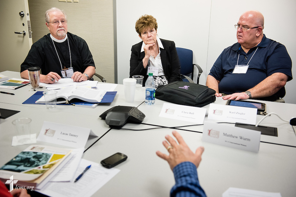 (L-R) The Rev. John Fale, executive director of LCMS Office of International Mission, Clara Ball, and the Rev. Karl Ziegler, senior pastor of First Lutheran Church in Papillion, Neb., listen during floor-committee weekend at the International Center of The Lutheran Church–Missouri Synod on Saturday, May 28, 2016, in Kirkwood, Mo. LCMS Communications/Erik M. Lunsford