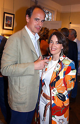 MR JAMES GILBEY and MRS LAVINIA HADSLEY CHAPLIN at a an exhibition of prints by art dealer Martin Summers held at 73 Glebe Place, London on 29th June 2004.
