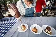 Dough Baby Bakery adds hot fudge to their caramel brownie ice cream sundae during the 4th annual Yum Yum Fest held at Breese Stevens Field, Sunday, August 6, 2017.