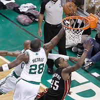 03 June 2012: Boston Celtics small forward Mickael Pietrus (28) blocks Miami Heat point guard Mario Chalmers (15) layup during the Boston Celtics 93-91 overtime victory over the Miami Heat, in Game 4 of the Eastern Conference Finals playoff series, at the TD Banknorth Garden, Boston, Massachusetts, USA.