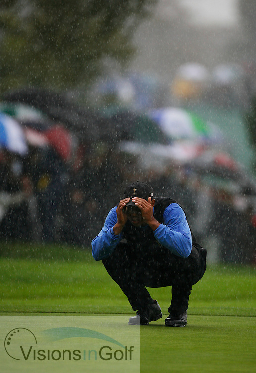 Tiger Woods looking at the line of his put on the 15th green in the rain on the second morning at the 36th Ryder Cup Matches 2006, K Club, Ireland, 060922<br /> Picture Credit: Mark Newcombe / visionsingolf.com