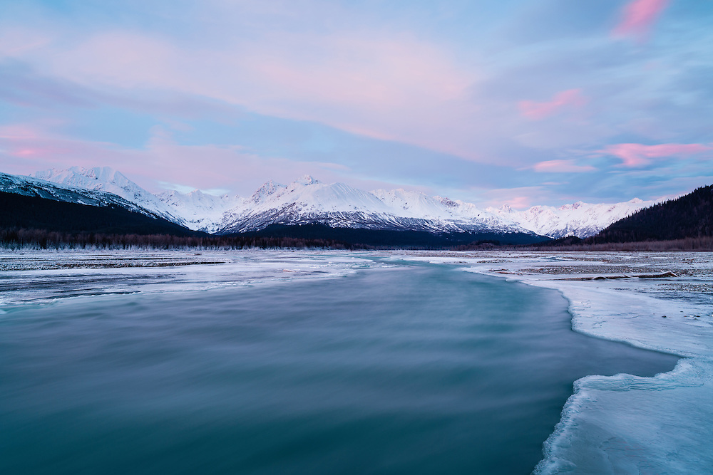 Alpenglow and long exposure of Klehini River in the Chilkat Bald Eagle Preserve near Haines in Southeast Alaska. Winter. Morning.