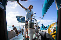 Patagonia ambassador Liz Clark keeps watch one way as her sidekick Amelia watches the other. French Polynesia